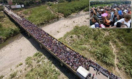 epa06509842 A handout photo made available by the the newspaper La Opinion shows an aerial view of thousands of Venezuelans entering Colombia through the Simon Bolivar international bridge in Cucuta, Colombia, 09 February 2018. Thousands of Venezuelans are trying to enter Colombia through the border crossing of Cucuta on the Simon Bolivar international bridge as new tighter border controls are being implemented. EPA/Juan Pablo Cohen/ HANDOUT HANDOUT EDITORIAL USE ONLY/NO SALES