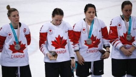 FILE: Jocelyne Larocque of Canada holds her silver medal in her hand, next to teammates wearing their medals during the medal ceremony. (Reuters)