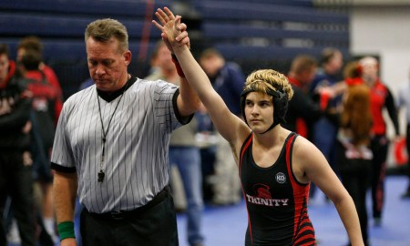 In this Feb. 18, 2017 photo, Euless Trinity's Mack Beggs is announced as the winner of a semifinal match after Beggs pinned Grand Prairie's Kailyn Clay during the finals of the UIL Region 2-6A wrestling tournament at Allen High School in Allen, Texas. Beggs, who is transgender, is transitioning from female to male, won the girls regional championship after a female opponent forfeited the match. (Nathan Hunsinger/The Dallas Morning News via AP) ORG XMIT: TXDAM101