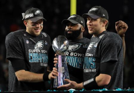 Malcolm Jenkins (center) has been a leader for the Eagles in pursuing social justice reform. (MIKE EHRMANN/GETTY IMAGES)
