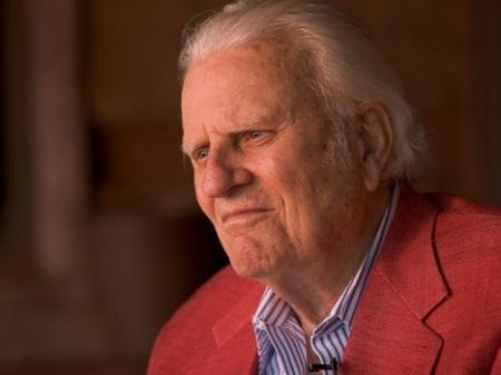 Billy Graham sits on the porch of his cabin May 12, 2005, in Montreat, N.C. Robert Deutsch, USA TODAY