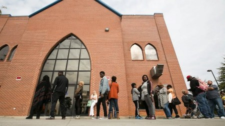 VOTERS LINE UP OUTSIDE LIBERTY BAPTIST CHURCH TO CAST THEIR BALLOT IN THE 2016 PRESIDENTIAL ELECTION ON NOVEMBER 8, 2016 IN ATLANTA, GEORGIA. (CREDIT: JESSICA MCGOWAN/GETTY IMAGES)