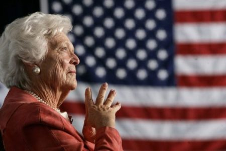 FILE PHOTO: Former U.S. first lady Barbara Bush listens to her son, President George W. Bush, as he speaks at an event on social security reform in Orlando, Florida March 18, 2005. REUTERS/Jason Reed