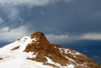 Lighting strikes a mountain peak