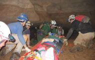 Search and rescue team attends to injured caver