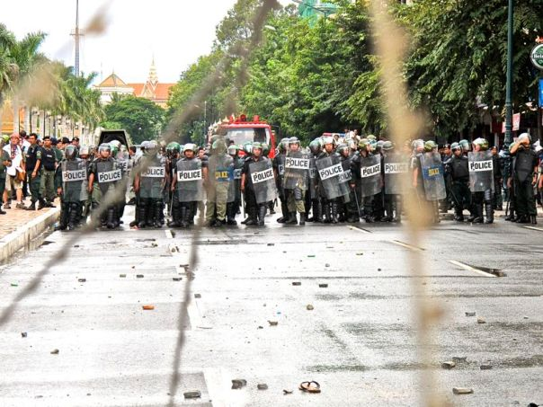 Military Police face off with protesters during three days of post-election protests in Phnom Penh. Credit: Will Jackson