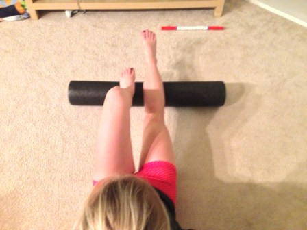 Foam Rolling Calves with one foot on roller