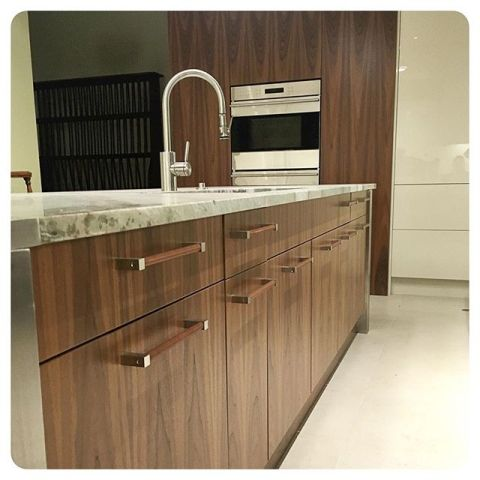 leather hardware installed on an island in a fab catering kitchen wilmetteleather.com