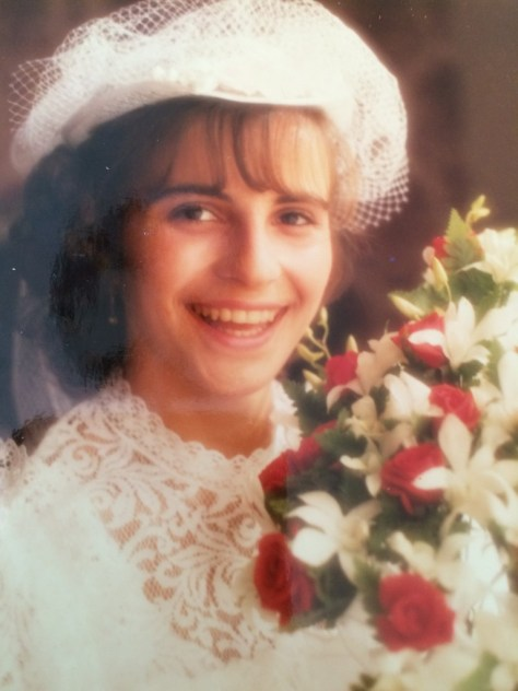 Luciana Grasso, destined to become mother of Paola, Valentina, and Federica, and nonna of Lidia and Anna, on her wedding day.