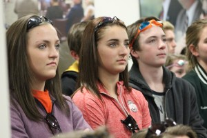 Swim team members Bailey Austin and Arielle Blake listen closely to speakers at the Buncombe County Commissioners meeting. Blake and Austin wore goggles in solidarity with the cause to keep Zeugner open. Photos by Ari Sen and Emily Treadway