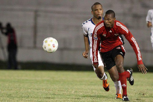 Photo: Trinidad and Tobago midfielder Atallah Guerra (right) in action against Martinique during the 2012 Caribbean Cup semifinals. Guerra scored Trinidad and Tobago's winner last night against Jamaica.