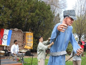 "Larger-than-life size puppet of 1886 labor leader ""speaks"" at annual Bay View Tragedy event."