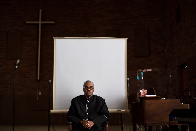 Flint, Michigan - March 3, 2016: Pastor Alfred Harris sits on the stage of his church, Saints of God Church, in Flint, Mich., on Thursday, March 3, 2016. Harris is an active member of the Concerned Pastors for Social Action, a group that has been active in advocating for Flint residents amidst the city's ongoing water crisis.