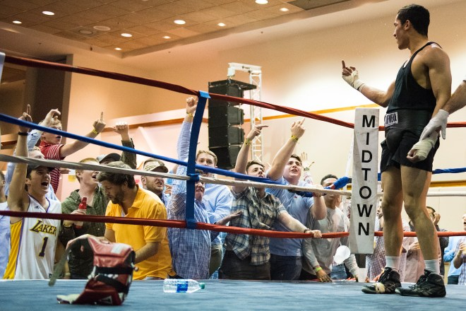 "Members of Sigma Chi yell and flip off Miguel Barzel after his fight in the 165 weight class at the Sigma Chi Battle of the fight night competition at the Salon Conference center March 18, 2016 in Bowling Green, Kentucky. ""Its fun to mess with them"" said Barzel after the fight."