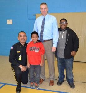 "Dr. Rhett Harris with ""Principal for a Day"" Chief Sonny Ledda. Cover Picture: ""Principal"" Amanda Munyan at Waterloo Elementary"