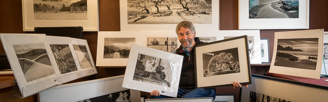 Marty surrounded by some of the inventory photographs available during 2016 benefit sale.