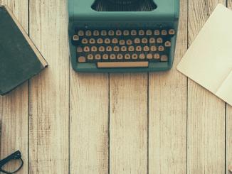typewriter and notepad