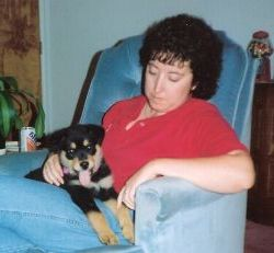 Rottweiler puppy, Woodrow, on Lorraine's lap.