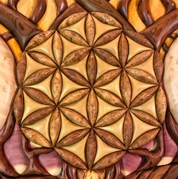 Part of my new piece! Finally finished at midnight... heading out in the morning to @enchantedforestgathering to hang at @branches_mobile_gallery #wood #woodvibetribe #floweroflife #mapleburl #andywoodsmith