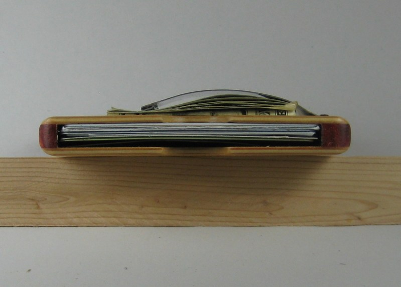 Side view with equivalent of six cards and some cash