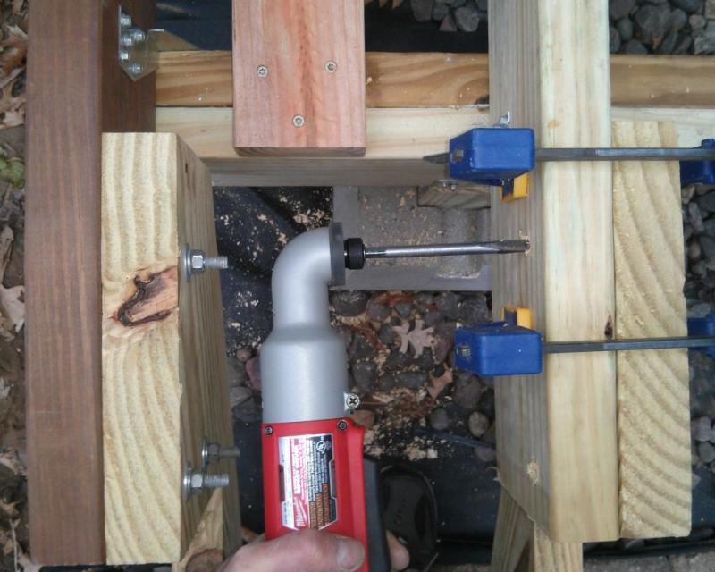 12 - Drilling the holes to attach the stringers with a right angle impact drill