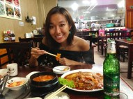 Enjoying the spicy Korean food