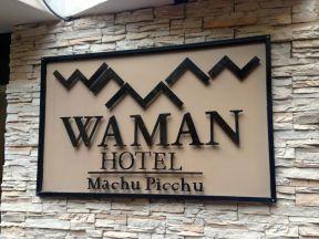 Waman Hotel Sign