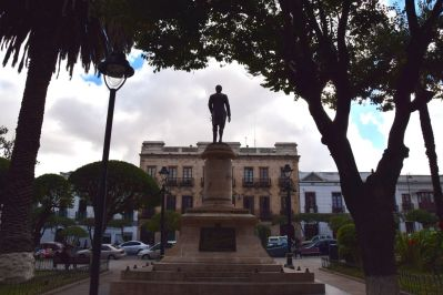 Sucre Square Statue in front of Building