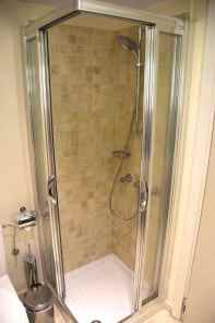 Standalone shower in guest bathroom