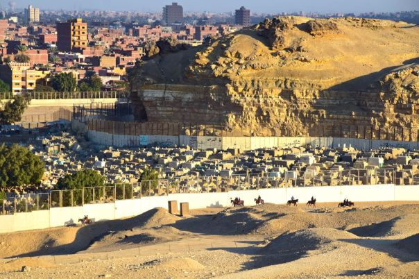 Tombs on the edge of the Pyramids and the city beyond.