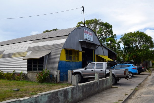 A hangar repurposed as a mechanic's shop.
