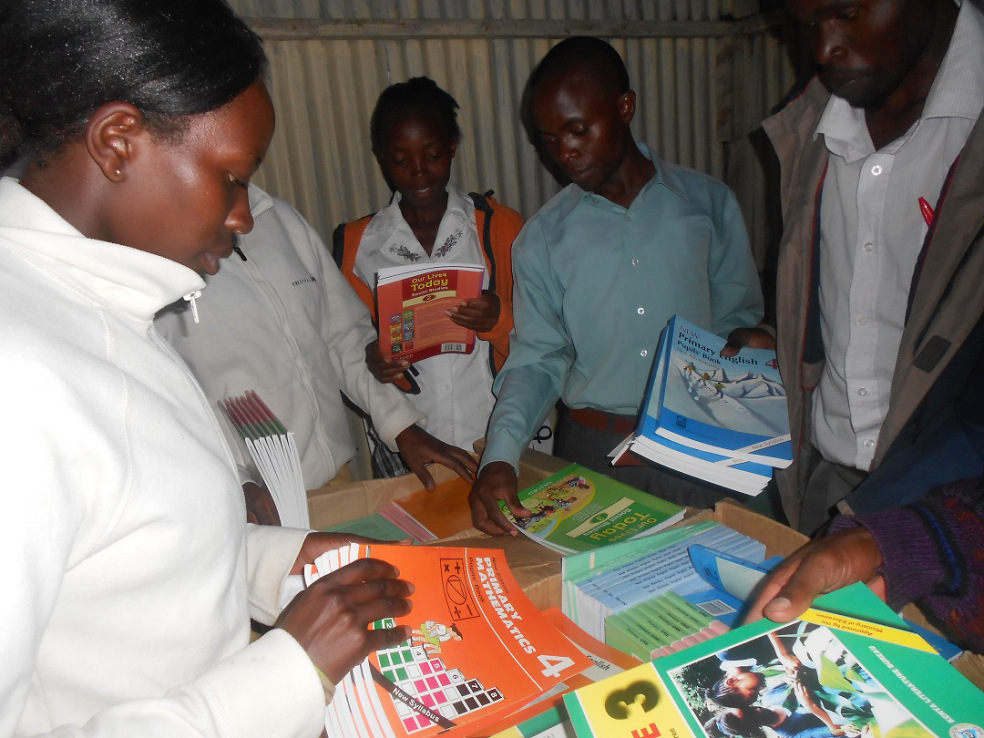 swanland-village-school-teachers-counterchecking-the-purchased-books