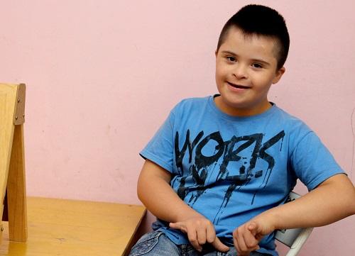 crianca-com-sindrome-de-down-1458853725Vg1