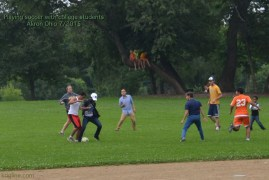 International students play a rousing game of soccer during a picnic