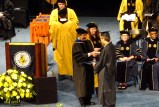 Walking across the stage.