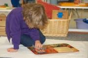 Child at work with Montessori materials