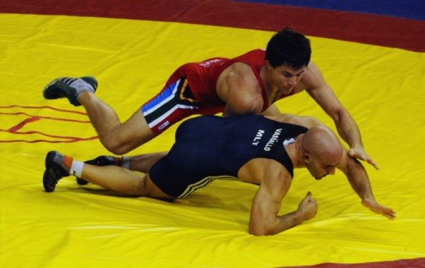 South Africa's Gerald Meyer in action againts A Vassallo of Malta in the wrestling freestyle competition