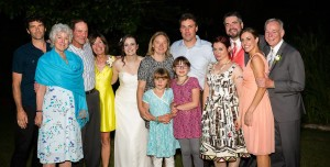Pauline (yellow dress), husband Michael (far right), and much of her family