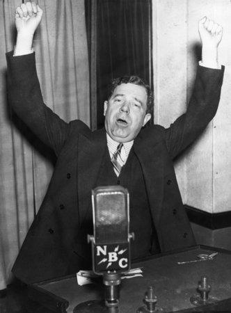 Senator Huey P. Long of Louisiana, warms up for a radio speech from his Washington, DC office on March 7, 1935.