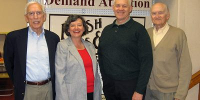 WRVHS Board Member Leon Combs, WRVHS Managing Director Leslie Wyman, Branson business owner Joe Reish, and WRVHS Board Member Jim Babcock pose in the Reish Shoes building.