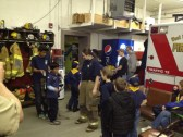 Crew Members teach fire safety for Cub Scouts