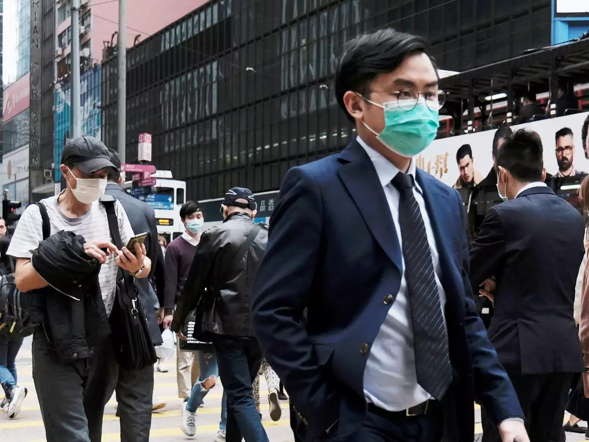 People wear protective face masks as they take their lunch breaks, following the outbreak of the new coronavirus, in Hong Kong.