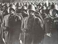 Polish soldiers at a pre-war torchlit review.