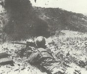 US infantry of 38th Division blast Japanese positions