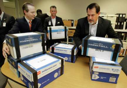 Jared Woodfill, left, David Welch, right, and others with a group seeking to repeal Houston's equal rights ordinance delivered boxes of signatures to the office of the Houston city secretary on July 3. Photo: Melissa Phillip, Staff / © 2014  Houston Chronicle