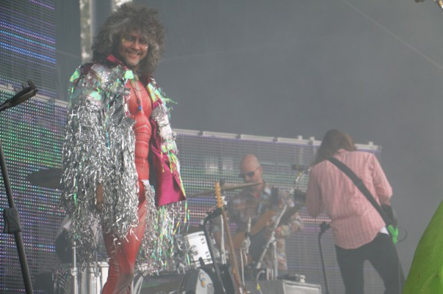 The Flaming Lips' Wayne Coyne, in his homeless Goblin King get up, looking real evil