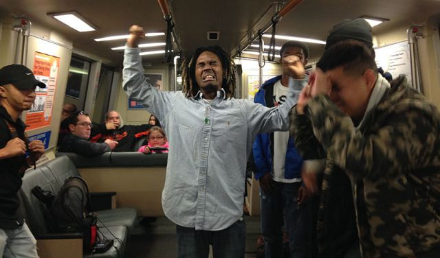 Dopey Fresh celebrates after pulling off a big dance move on a BART train