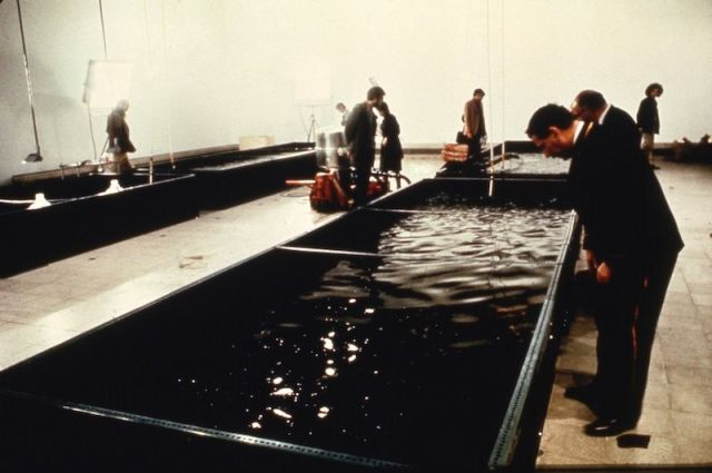 """People exploring the Harrisons' """"Portable Fish Farm"""" installation in 1971"""