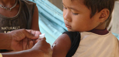 A Cambodian boy receives the measles vaccine.