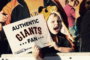 A young fan screams her support.